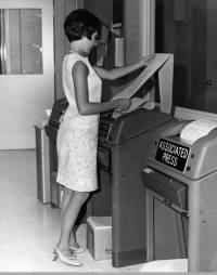 Woman at news teletype